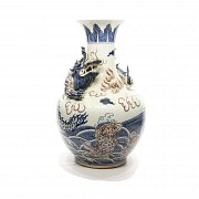 Chinese pottery vase blue and white glazed, 20th century. Decorated with red enamel and a relief dra
