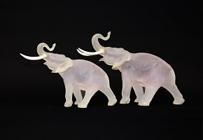 Pair of opaque glass elephants and bone fangs