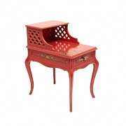 Red lacquered wood side table with oriental decoration and gold accents.