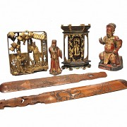An antique polychrome carved wood group of six figures.