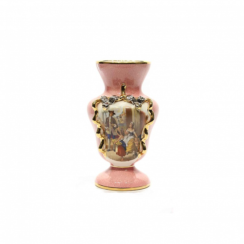 English Porcelain vase, 20th century. Decorated with a pink ground and a couple scene.