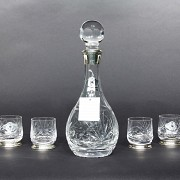 Set of decanter with six glass and silver glasses.