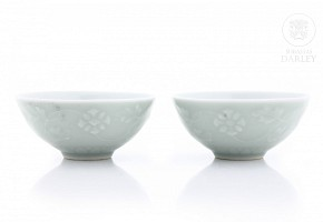 Pair of green glazed bowls with flowers, 20th century