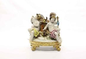 Glazed porcelain centerpiece representing god Bacchus on a base, Sebastian Mallol factory, 20th cent