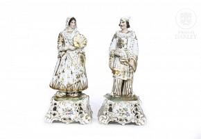 Pair of Elizabethan porcelain figurines, 19th c.