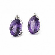 Earrings in 18k white gold with amethysts and diamonds.