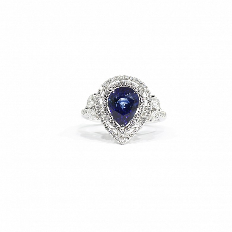 Ring with a central sapphire.