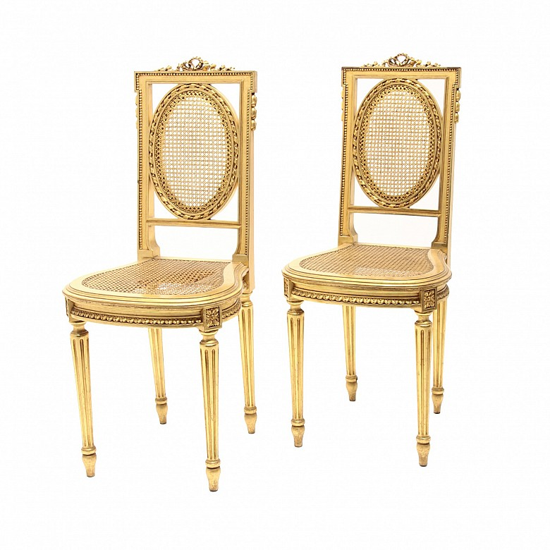 Pair of golden wood chairs, seat and backrest of grid, Louis XVI style,