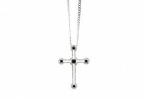 Cruz de oro y diamantes negros y blancos.