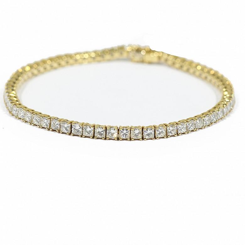 Pulsera riviére en oro amarillo de 18k y diamantes.