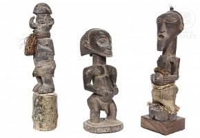 Three sculptures of African warriors.