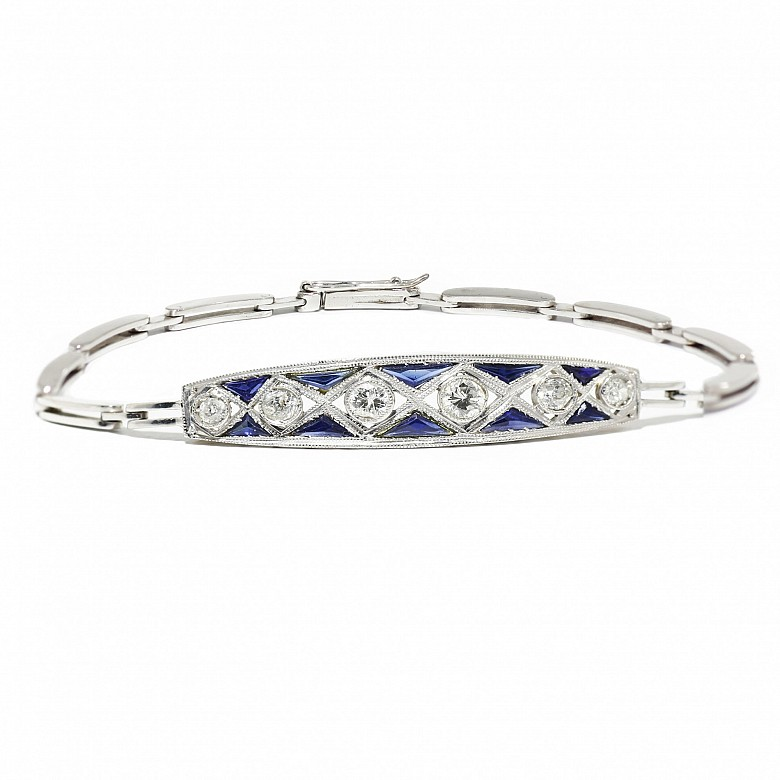 Bracelet with brilliant and sapphire front calibrated in platinum and links in 18k white gold