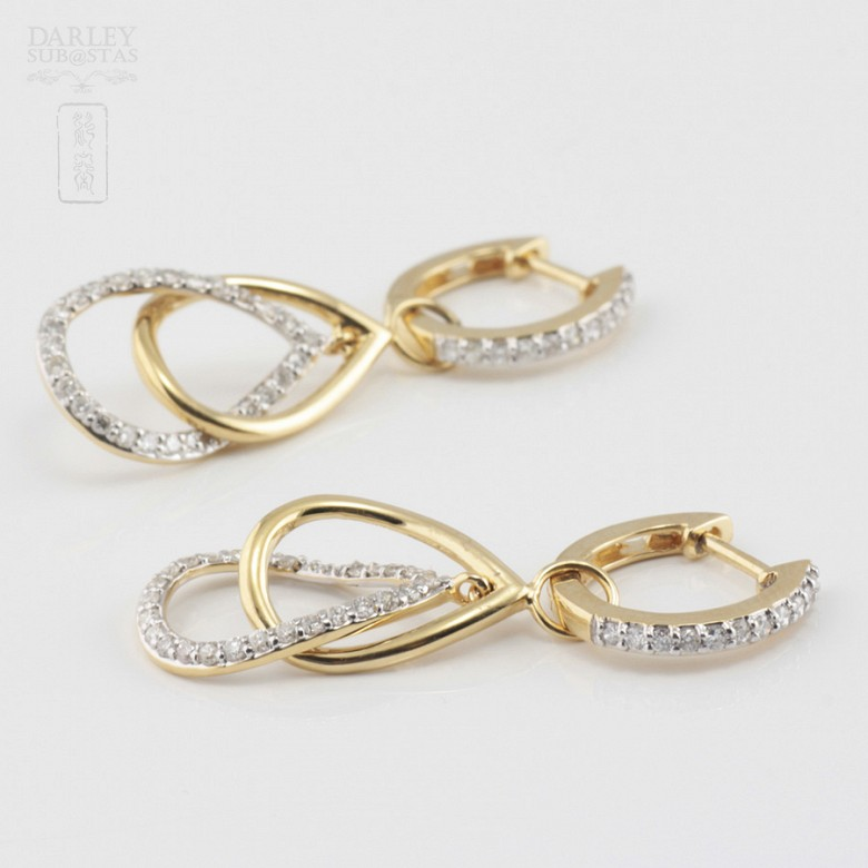 Pair of earrings with movement, in 18k yellow gold and 74 diamonds total weight 0.70cts. - 4