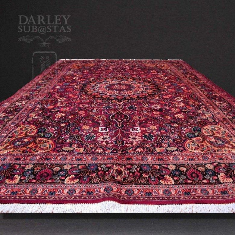 Kashmir rug is hand-knotted