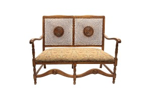 Canapé of walnut and grid backrest with rosette, 20th century