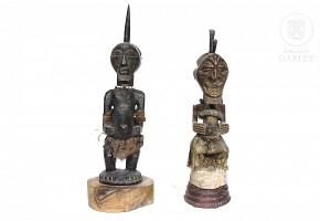 Two sculptures of African warriors.
