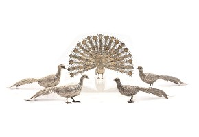 Group of four pheasants and a silver-plated metal peacock, 20th century
