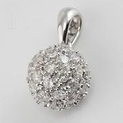 Colgante bola con 0.97cts diamantes