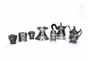 Lot of small silver punched objects.