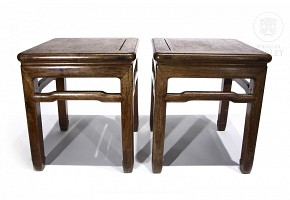 Pair of carved wooden stools, 20th c.