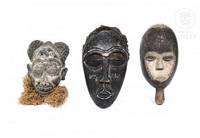 Three decorative African masks.