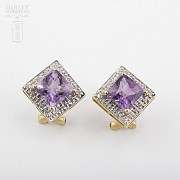 Elegant pair of earrings in 18k yellow gold with amethyst and diamonds