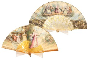 Two fans with country wallpaper