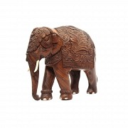 A carved wood elephant.