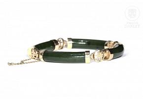 Jade and 14k gold bracelet.