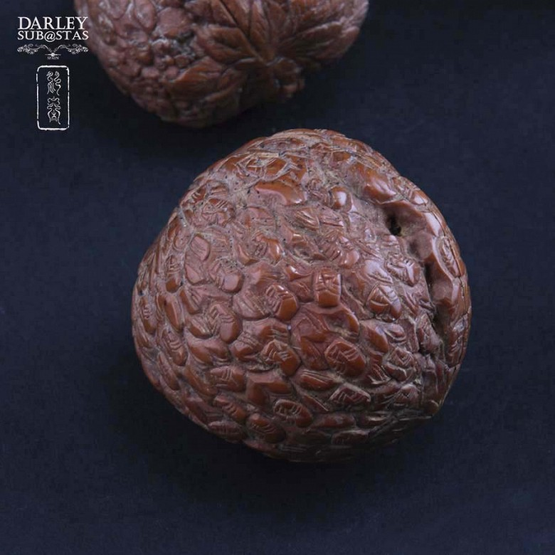 Four carved nuts - 2