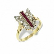 Shuttle ring with antique cut diamonds and rubies