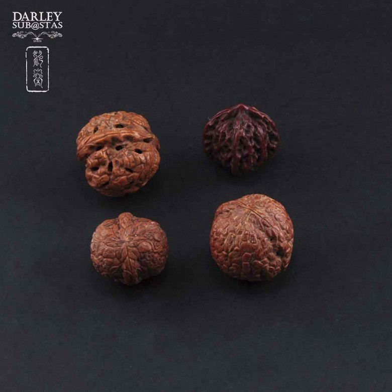 Four carved nuts