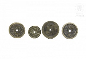 Four Chinese bronze coins.