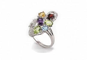 Anillo en oro 18k con gemas de colores y diamantes.