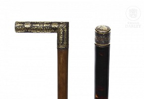 Two canes with damascened iron handle, 20th century