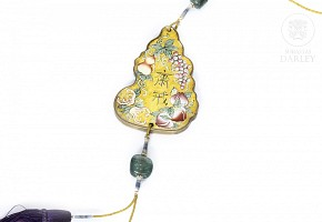 Enameled bronze ornament and two tourmalines, Qing Dynasty.