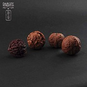 Four carved nuts - 4
