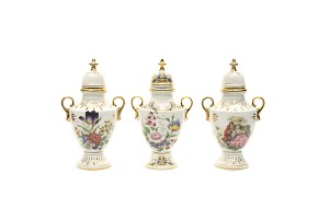 Lot of three european porcelain vases with lid. 20th century.