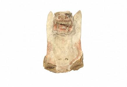 Cabeza de terracota, guardián de tumbas