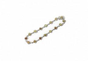 Pulsera riviére en oro blanco de 18k con diamantes.