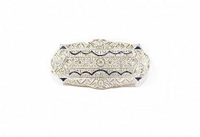 Broche placa con diamantes y zafiros en montura de oro y platino