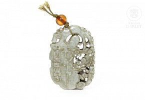 Carved jade piece and an amber bead, Qing Dynasty.