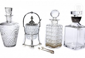 Three glass decanters and a sugar bowl.